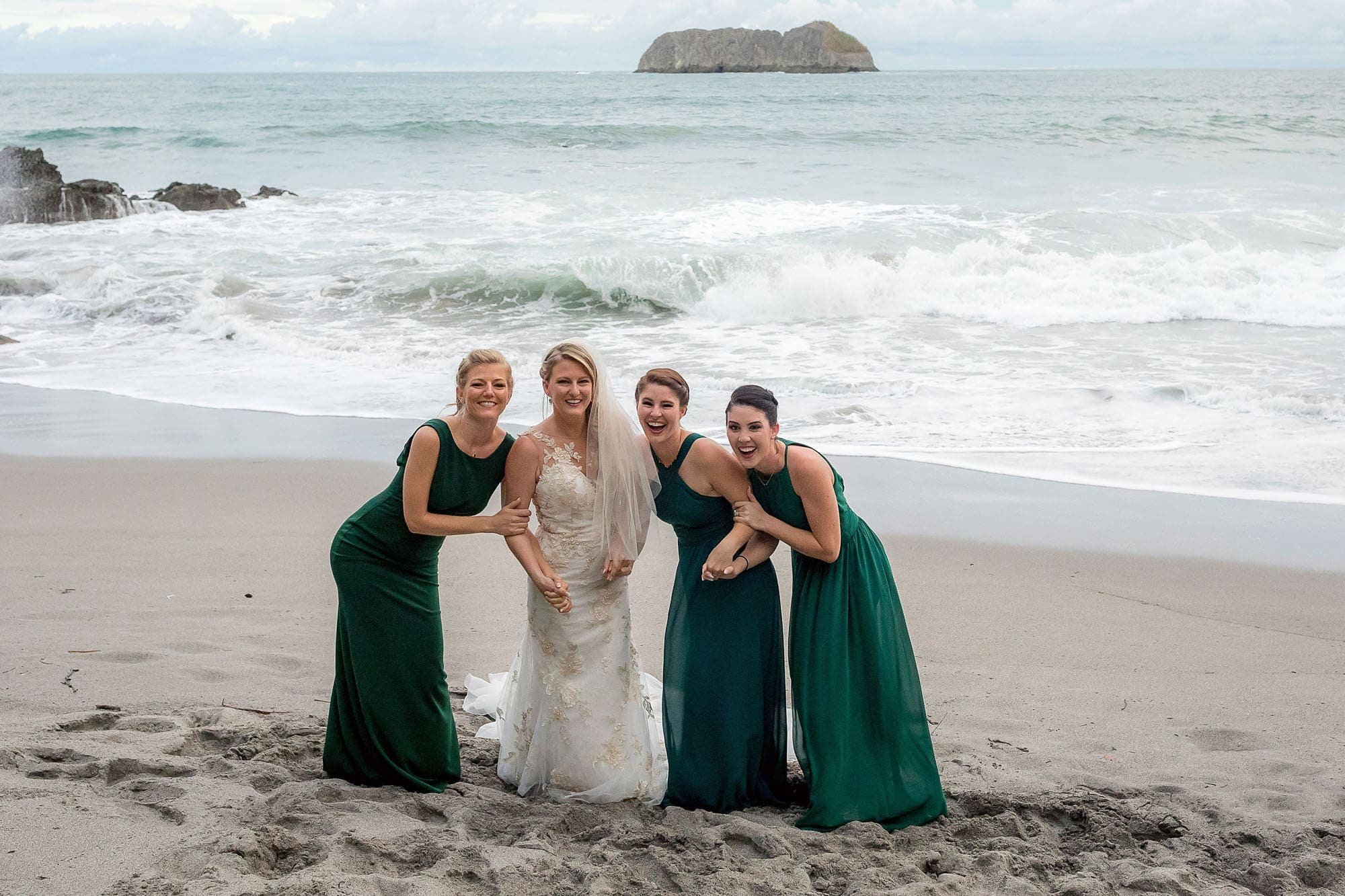 The bride and her girls on the beach