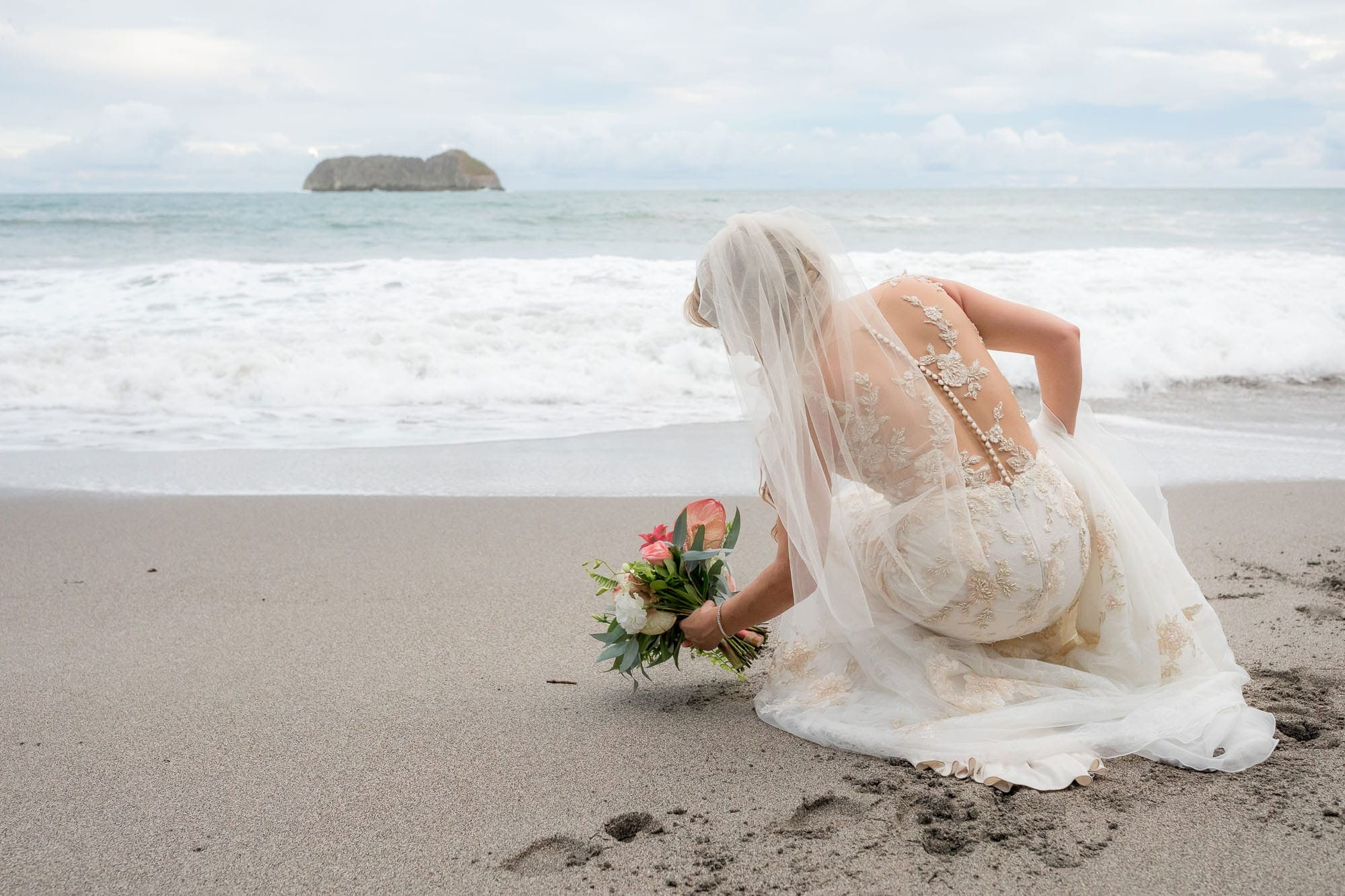 The bride on the beach before the beach wedding reception