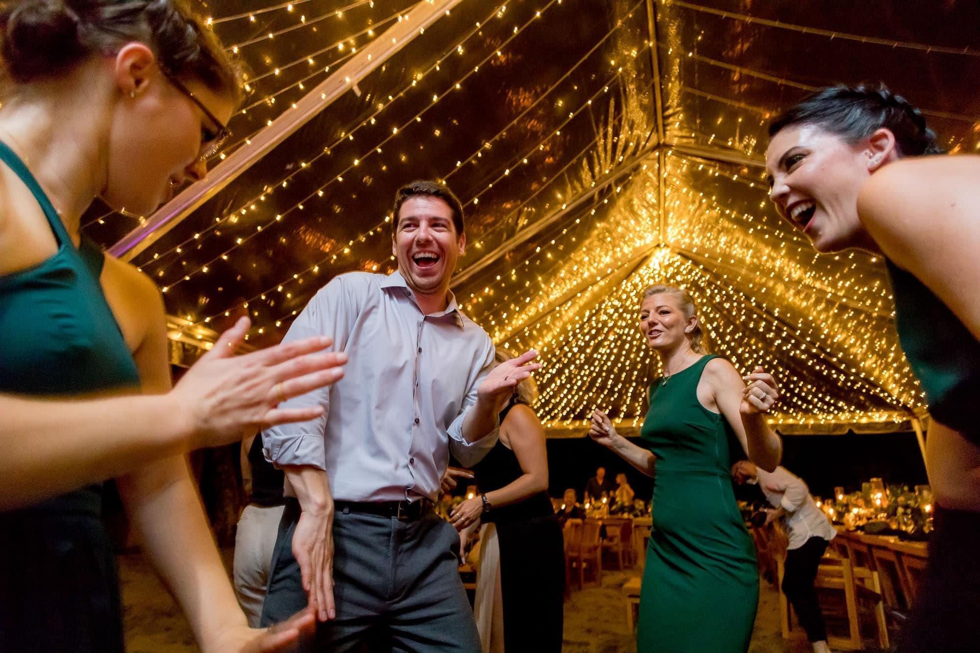 Dancing at the beach wedding reception
