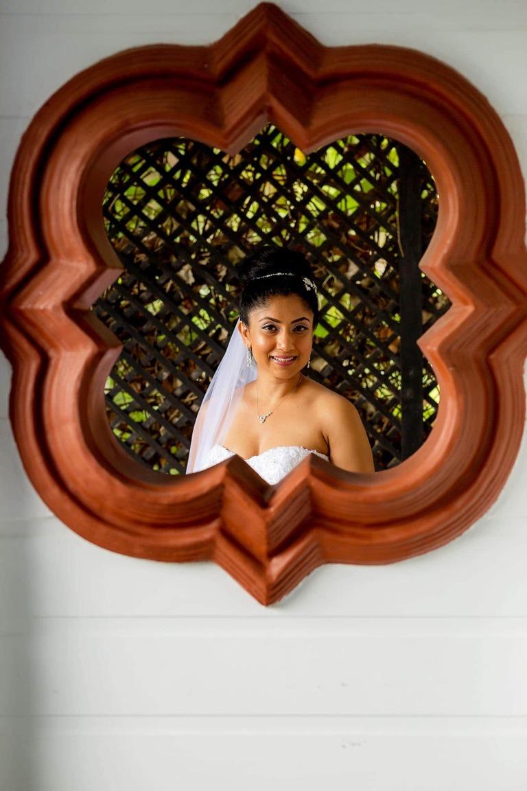 The bride through an elegant window