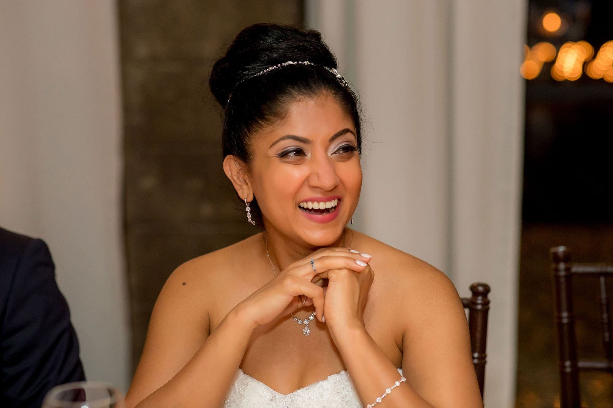 The bride smiling during the reception