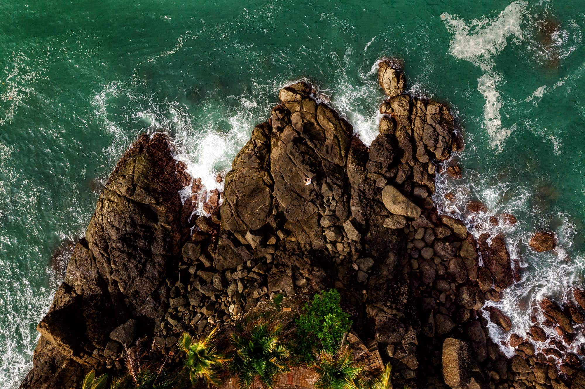 Overhead shot of the bride and groom on the rocks at Nahomi