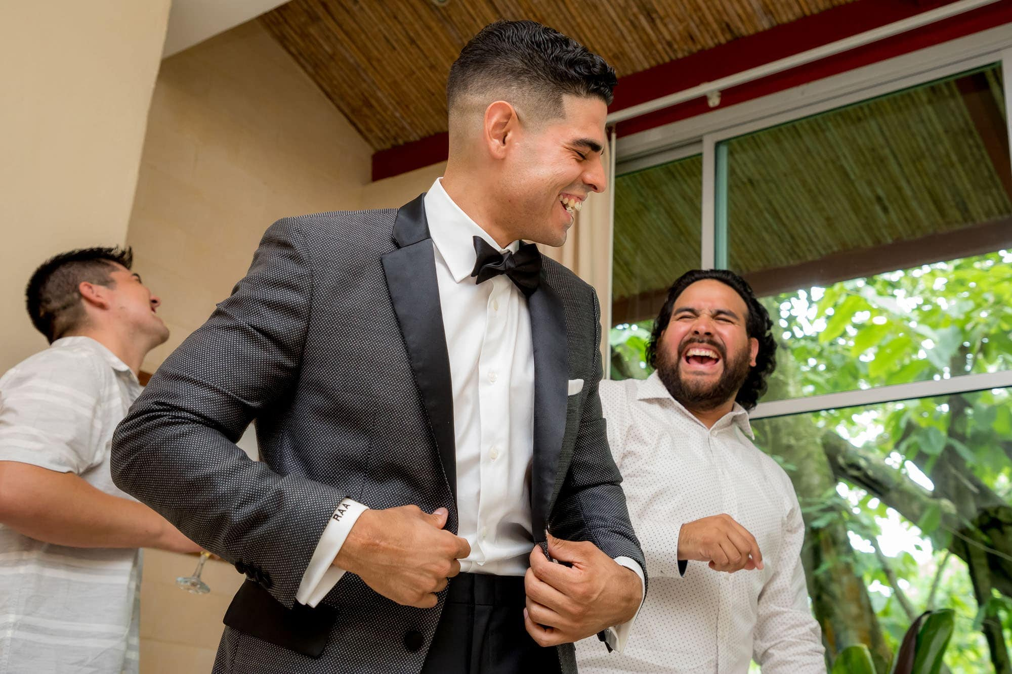 The groom laughing with a friend
