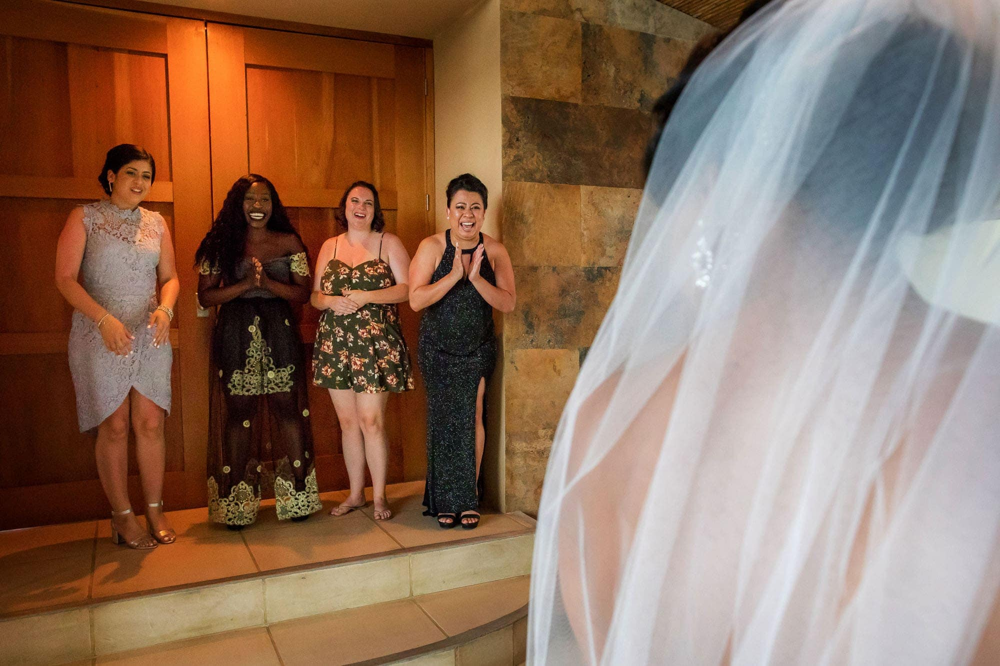 The bride's friends are delighted by her appearance