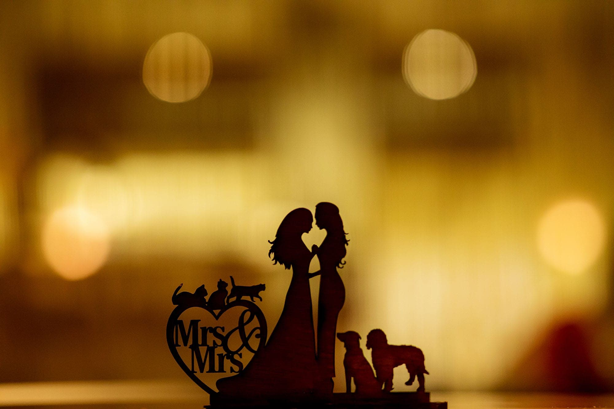 custom cake topper at wedding with pets