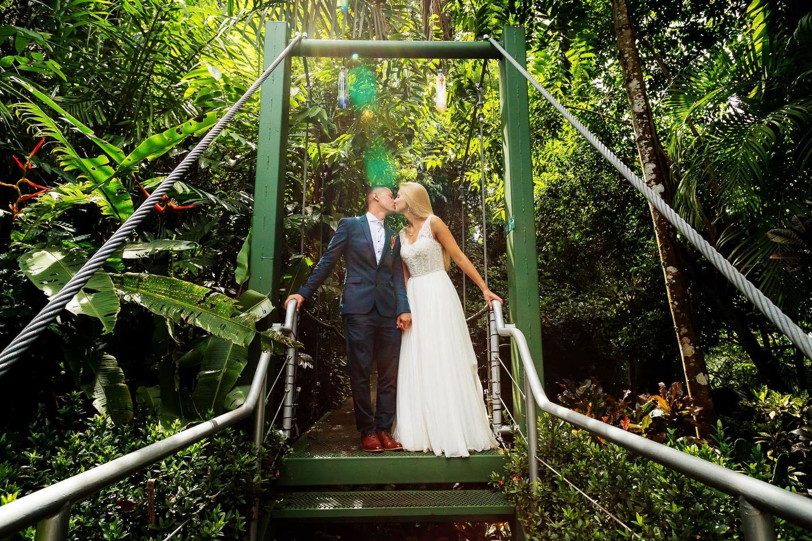 bride and groom on suspension bridge