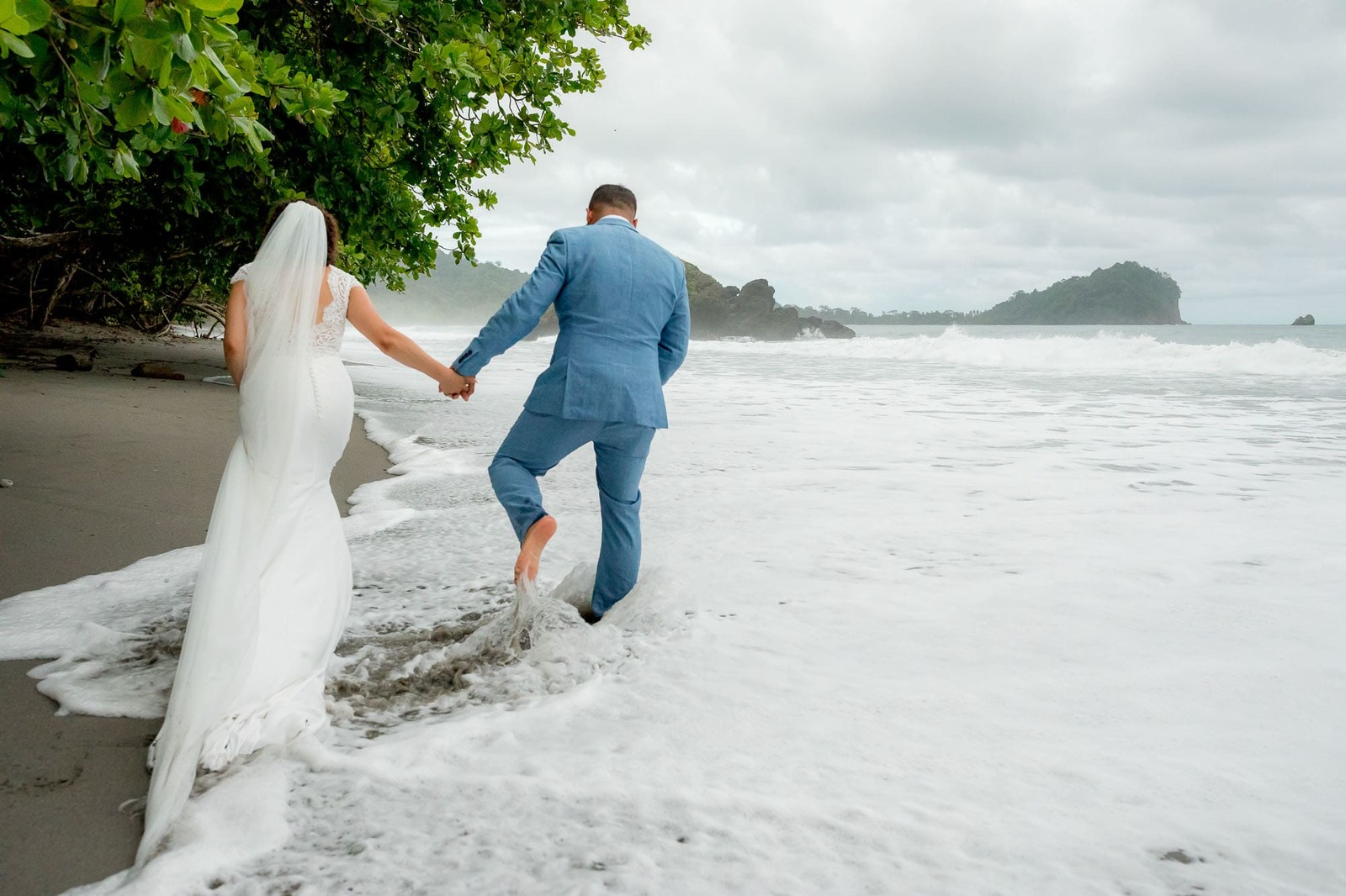 wedding couple in waves