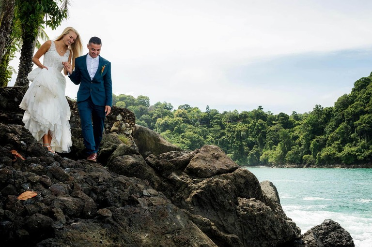 Bride and groom navigate the rocks at Nahomi for the day after their church wedding session