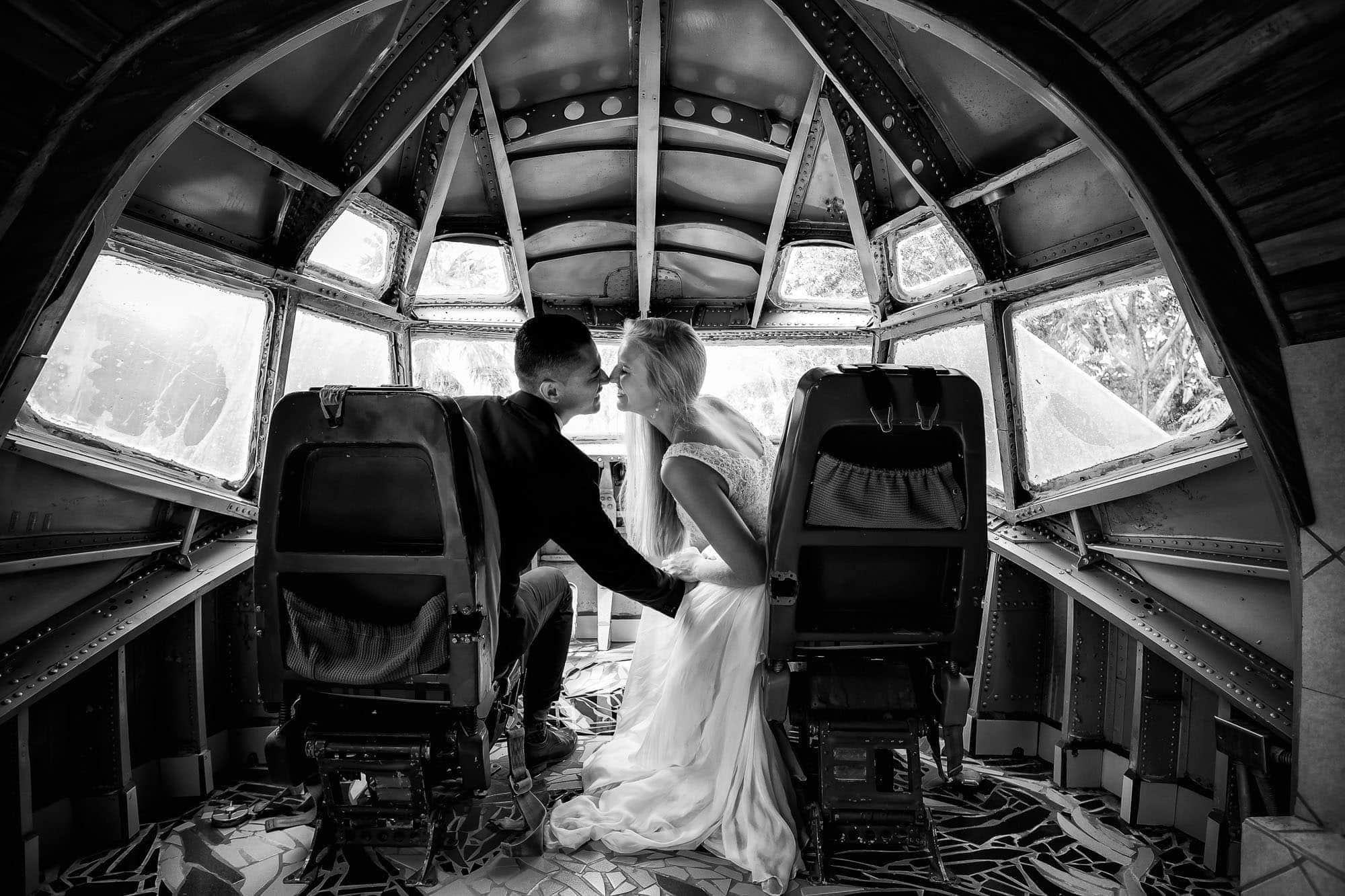 Sharing a kiss in the cockpit of the airplane the day after the church wedding ceremony