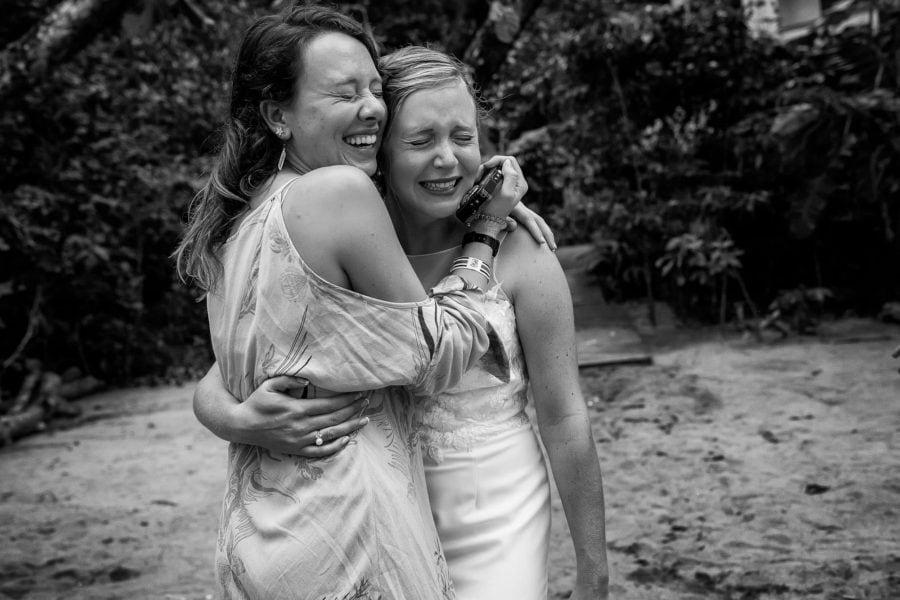 The bride hugging a wedding guest