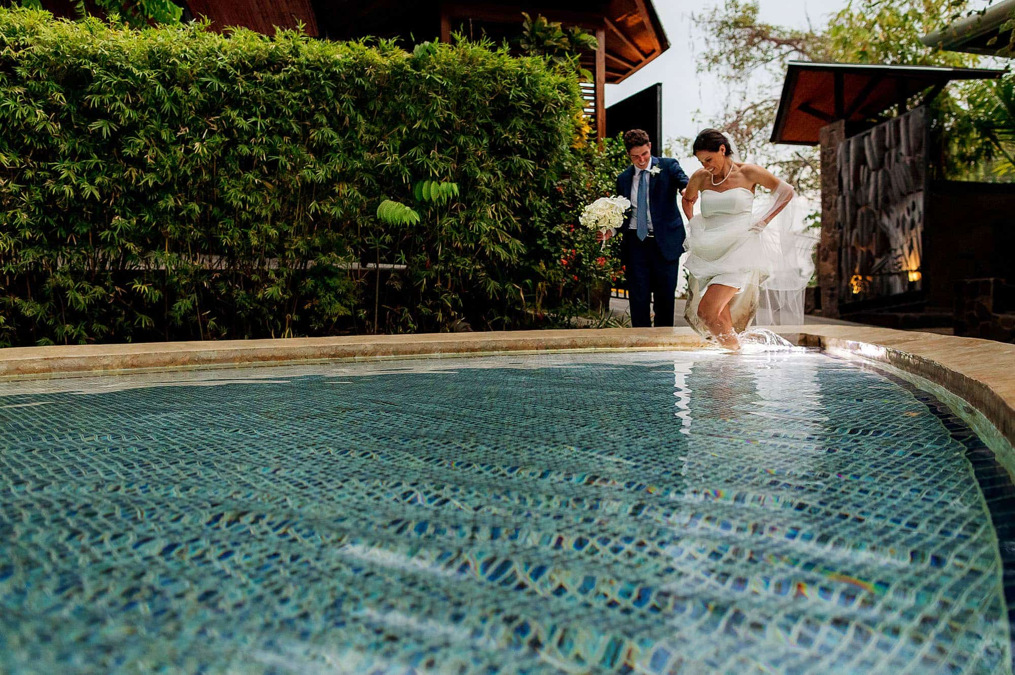 wedding couple in pool