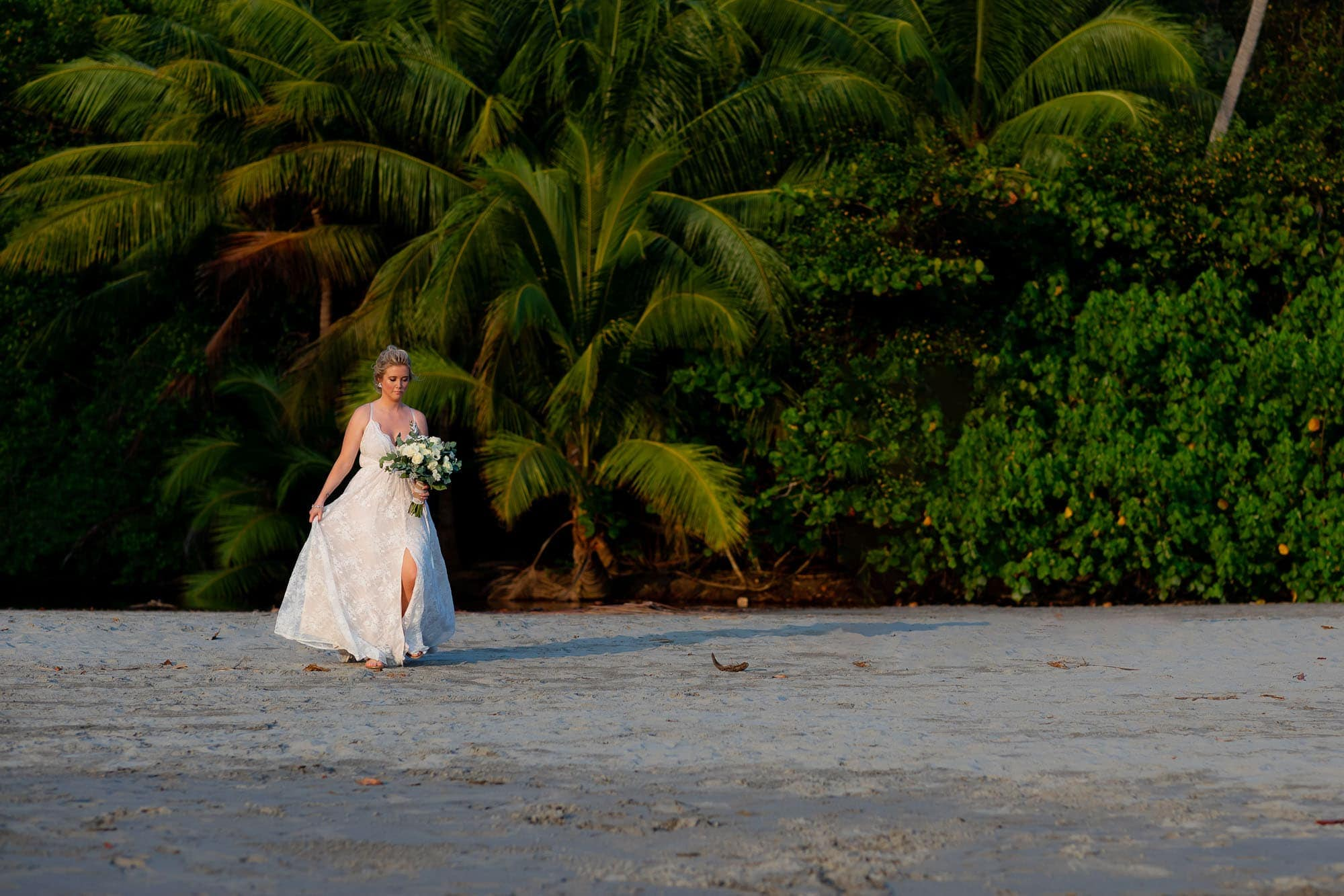 The bride arriving at the ceremony location on the beach