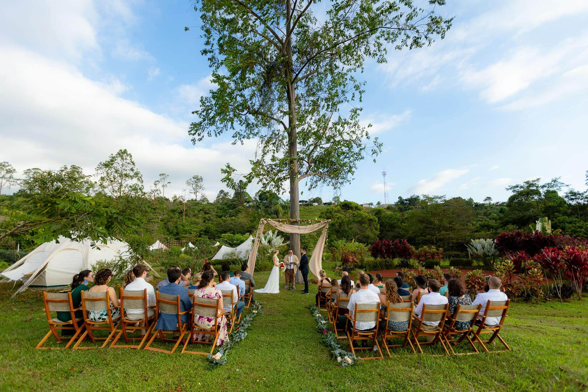 The ceremony of a glamping wedding