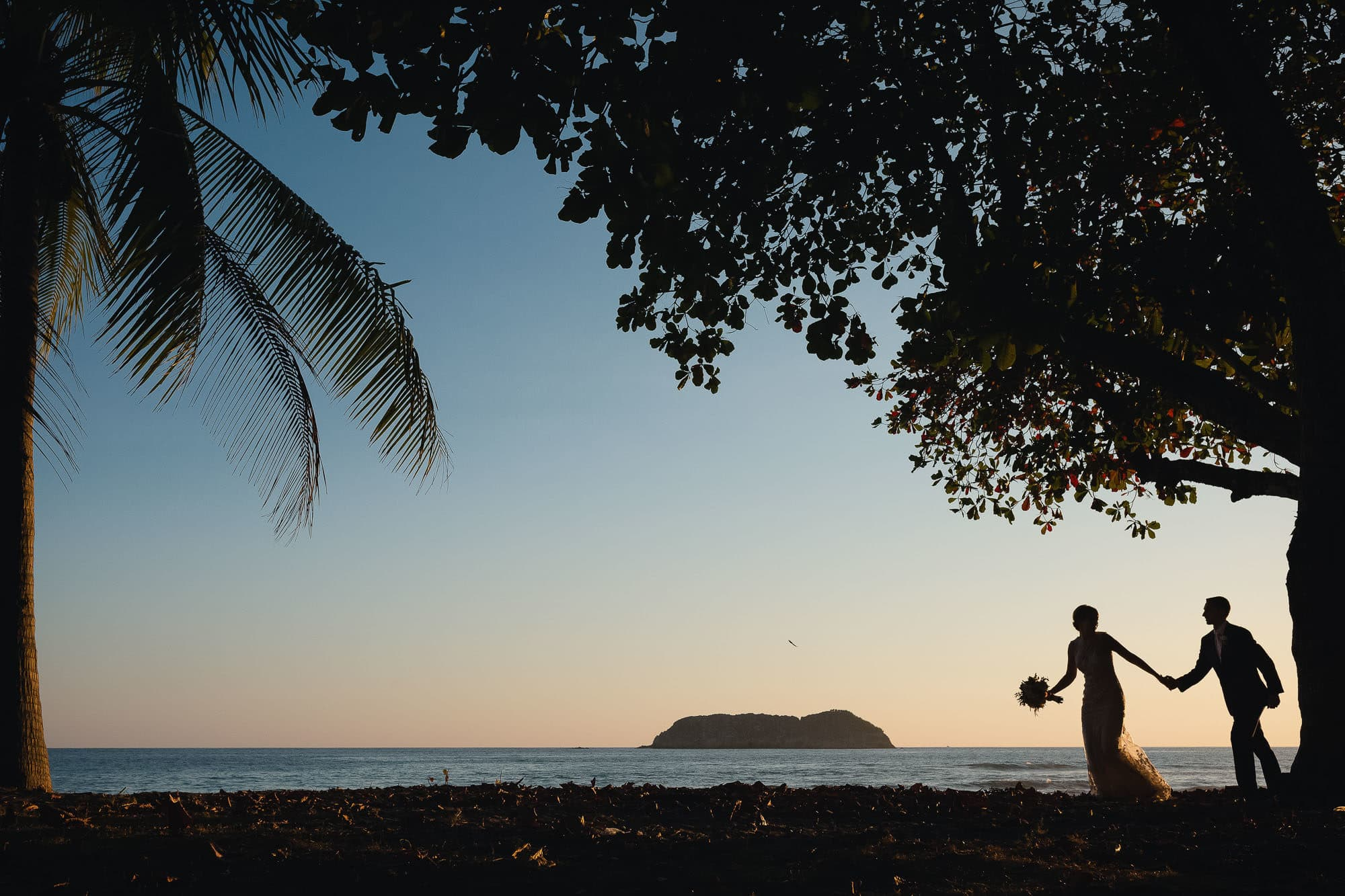 bride and groom at sunset on beach