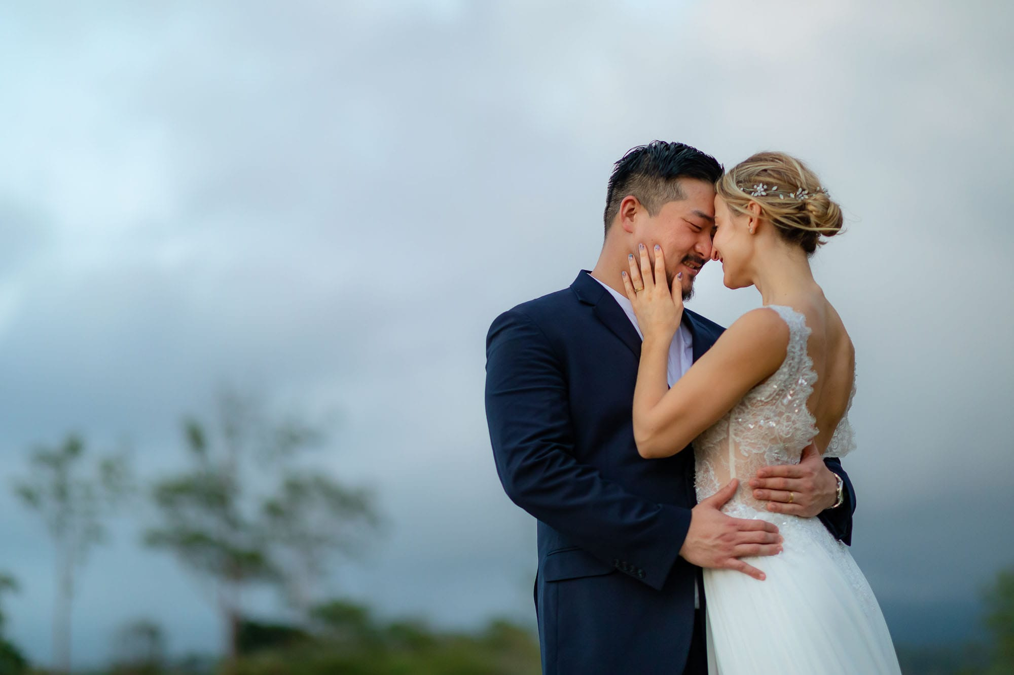bride and groom with sky