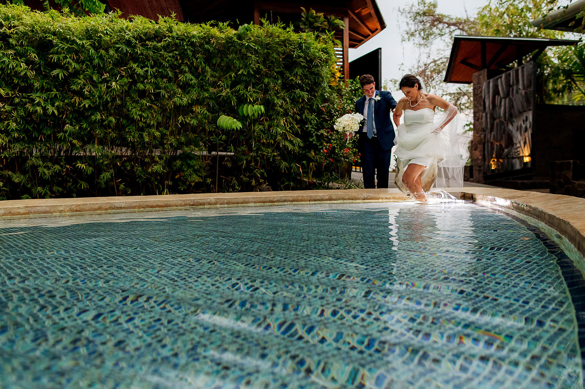 bride and groom in water
