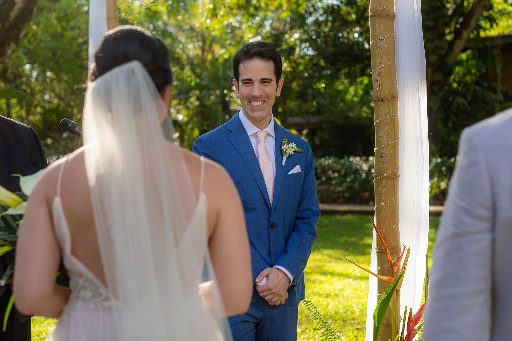 The groom's smile as he sees the bride as she comes down the aisle