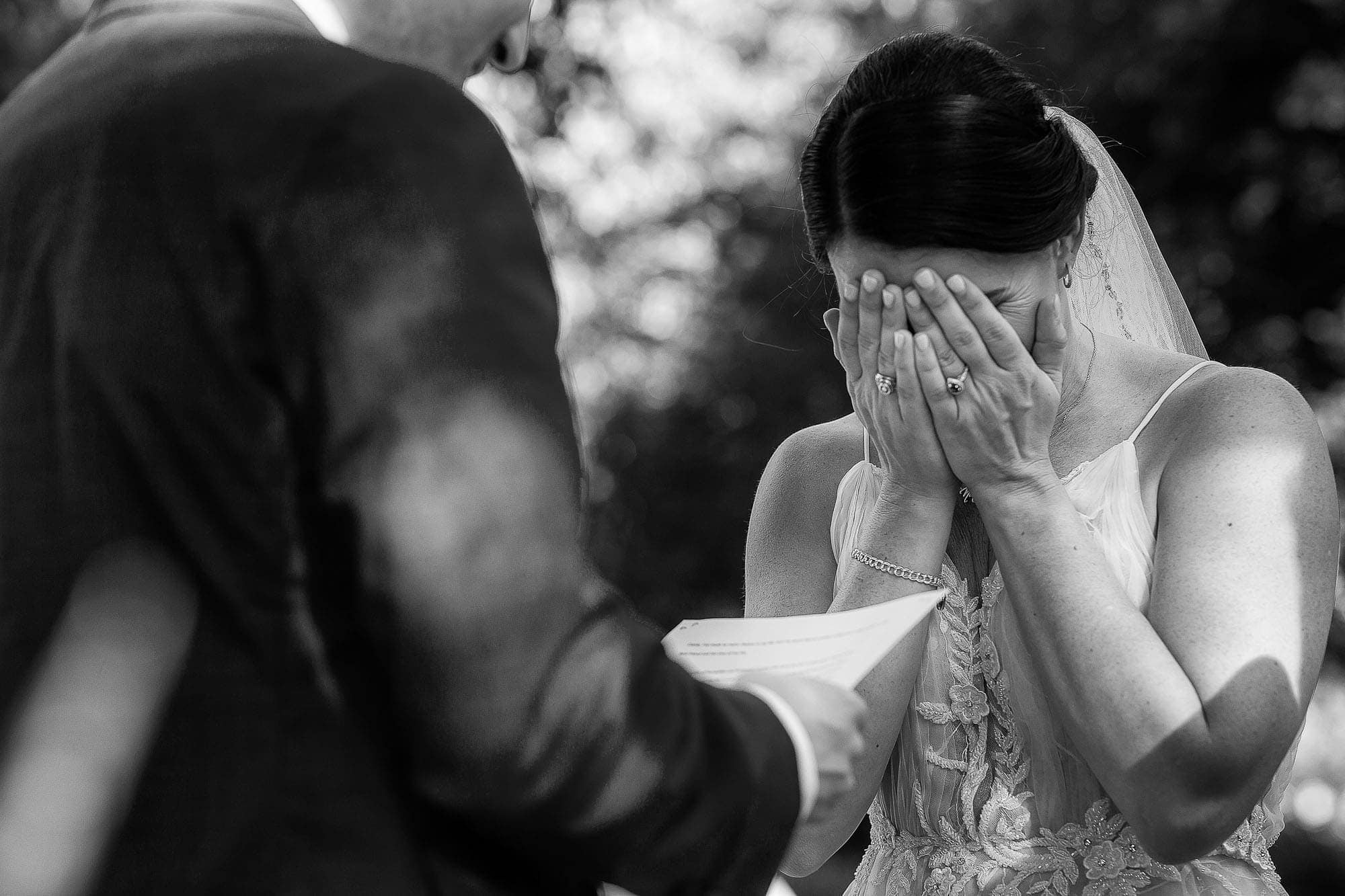 the bride weeps as her groom says his vows