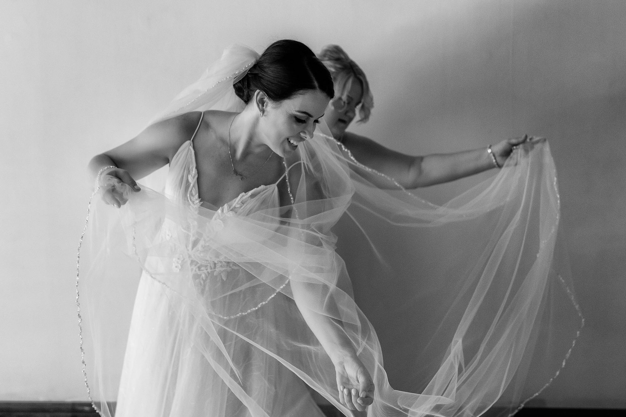 The bride arranging her veil while getting ready