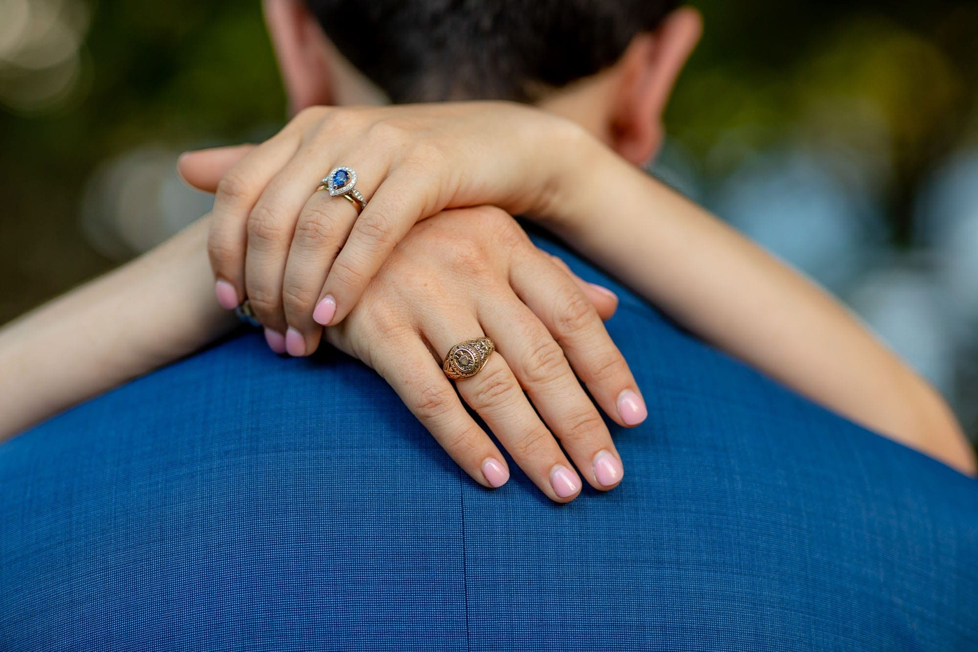 closeup of the bride's hands on the back of the grooms neck