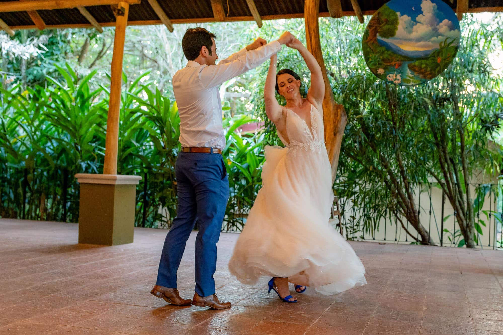 bride and groom on the dance floor at doce lunas